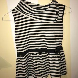 Black and white peplum sleeveless shirt